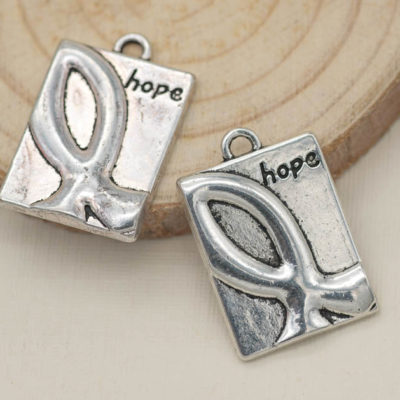 Cancer ribbon hope charms, silver color made lead free metal. Size x 17mm tall x 13mm wide x 1mm thick.