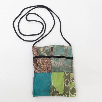 Fabric bag made out of recycled sari material. Size approximately 71/2 inch tall x 61/1 inch wide, 24 inch strap, Outside zip pocket, no main zip or closure.